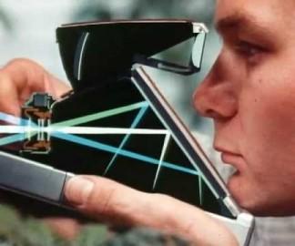Publicité expliquant le fonctionnement du Polaroid SX70