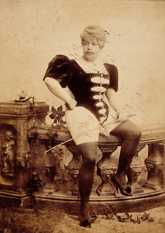 L0031641 Photograph of a man dressed in women's clothing