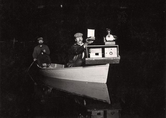George Shiras photographs wildlife in natural environments at night.