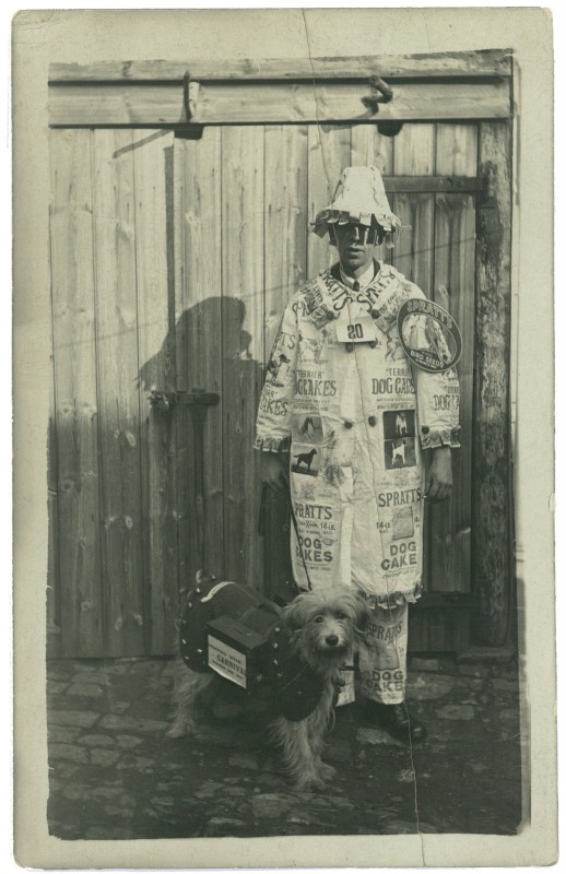 Portrait of a young man in fancy dress advertising Spratts dog cakes, circa 1900s