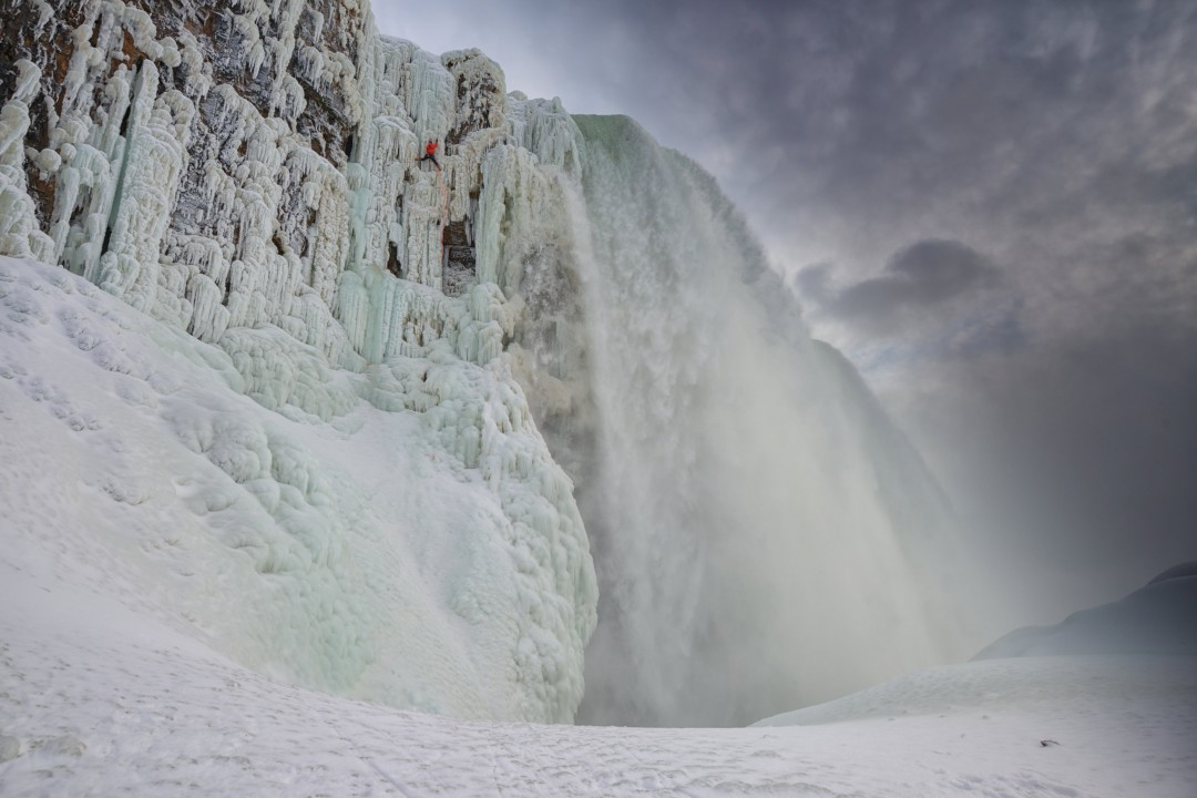 Will Gadd ice climbing on frozen Niagra Falls and about to make history during the first ascent ever of the worlds most famous waterfall