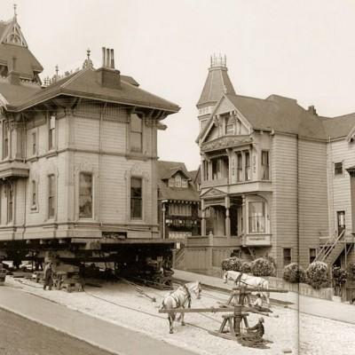 Moving a house using horses. San Francisco, 1908