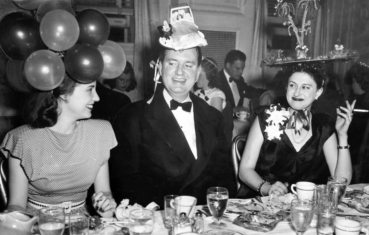 The Mad Hatters' Ball, a Junior League dinner-dance. Left to right: Mrs. William Sample, City Commissioner Arthur Weaver and Mrs. Weaver. S.J. MELINGAGIO/THE WORLD-HERALD ran May 4, 1947