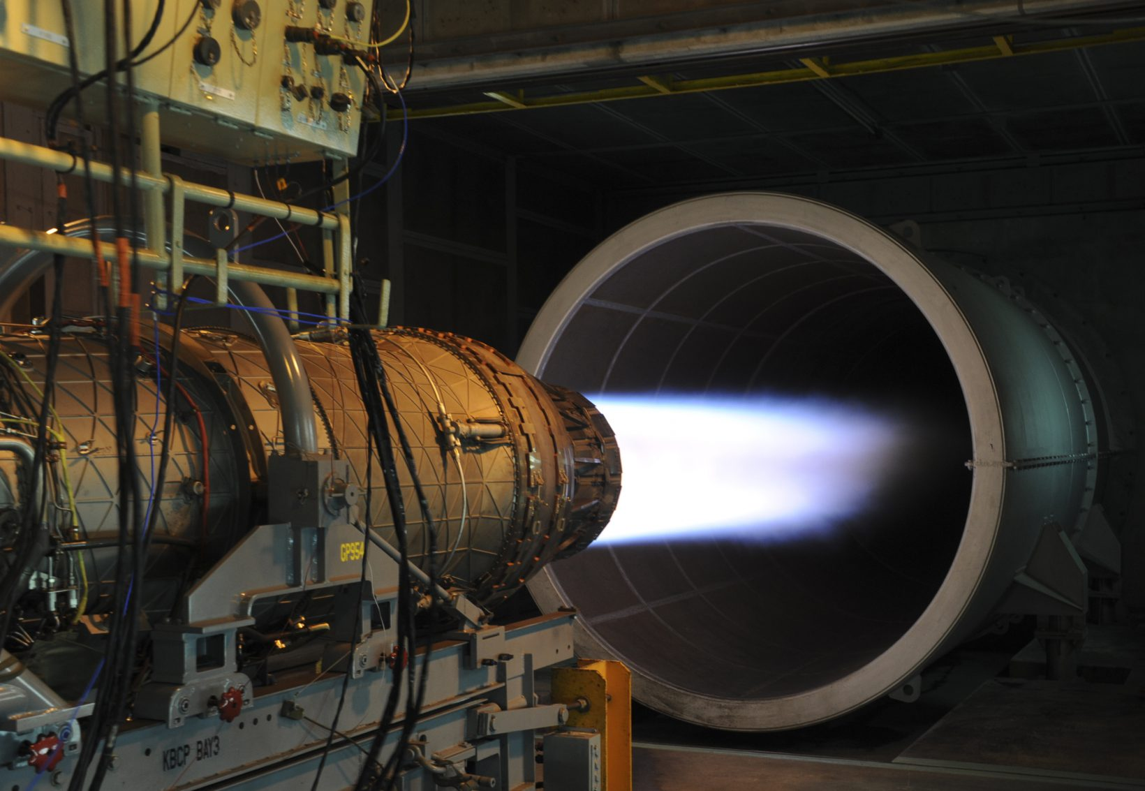 A U.S. Air Force F-15 Eagle fighter jet engine is pushed to maximum speed during a routine engine test at the 18th Component Maintenance Squadron on Kadena Air Base, Japan, June 26, 2012. 18th CMS engine test facility is primarily used for testing uninstalled engines following maintenance, and is also used as a trim pad to perform tests on highly powered aircrafts that run above 80 percent of the engines rated capacity. (U.S. Air Force photo/Airman 1st Class Justin Veazie)